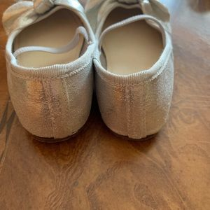 Silver ballerina shoes with bow